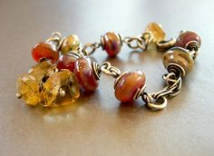 glass lampwork bead bracelet with citrine and sterling silver