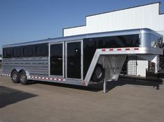 2016 Elite 24' Show Stock Deluxe w/ Ten Pen System. #16575. 8 x 24 x 6.5 Tall. Drop Down Windows on Both Sides, Hinged Cover Panels, Roof Vents, 50/50 Ten Pen System, Rear Ramp, 4' Dressing Room w/ Walk Through Door, Extra Hooks & Feeder Bracket Rods, Escape Door w/ Gate, Polished Sides, Black Skin, Stainless Nose, Spare Tire...Sale Price: $37,000.00