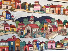 Mural bordado en lana y en punto de cruz