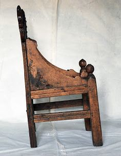 Chair from Gålås, Ringsaker, Hedmark with carved animal heads. The backrest is 13th century, the front a 18th century restoration. Note that the chair legs are uneven.