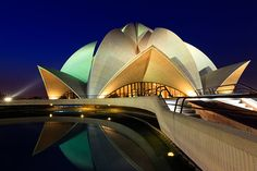 The Baha'i House of Worship, more commonly known as the Lotus Temple due to its flowerlike shape, designed by Iranian-Canadian architect Fariborz Sahba. Baha I Faith, Lotus Temple, Central Hall, Chief Architect, Architectural Elements, Beautiful Buildings, Travel Photographer, Futuristic, Worship