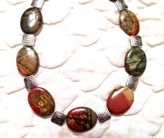 SOLD. Beautiful Red Creek Jasper ovals combined with modern square Pewter beads. A modern design with some Southwestern style~ In my Etsy shop