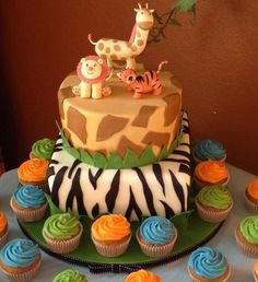 Safari themed baby shower cake. Animal figurines are made out of gumpaste. Top tier is styrofoam, bottom tier is a butter cake w/ whipped cream filling.