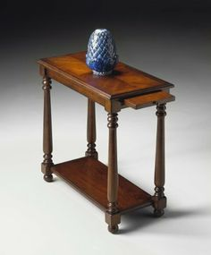 Butler Specialty 5017024 Chair End Table, Plantation Cherry # 5017024 by BUTLER-FURNITURE-ACCENT-SPECIALTY. $229.00. Selected solid woods and choice cherry veneers. Four-way matched cherry veneer top with cherry veneer border. Cherry veneer bottom shelf. Pull out ledge with antique brass finished hardware. # 5017024