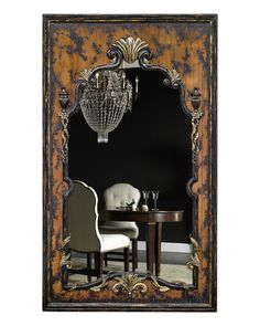 A beautiful oversized #mirror doesn't just add to your décor; it makes a room appear bigger and doubles views for an elegant effect. This mirror features a carved wood frame with a heavily distressed black finish and exposed walnut stain with gold leaf accents. It stands out in any room of your home…from floor to ceiling!