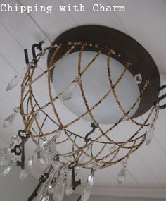 Chipping with Charm: A Chippy Welcome...flower basket light fixture http://chippingwithcharm.blogspot.com/2011/02/chippy-welcome.html