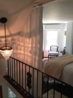 Gallery - Fabrics Unlimited Scrim drapes provide privacy for this Loft