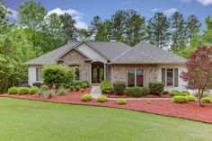This Stunning Lake Hartwell property is a must see! Custom built ranch home with an open floor plan that's perfect for entertaining and living the lake life. Three bedrooms, 2.5 baths on main level. Covered patio, in-ground salt water swimming pool with diving board and slide, fenced w/outdoor shower area. Paved walking path to the lake with covered boat dock in place, deep water and gorgeous views.