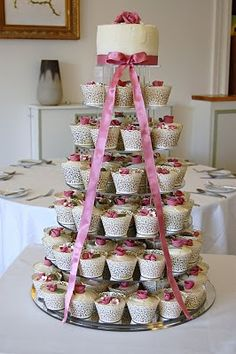 Beautiful cupcake tower, with lovely cupcake cases.