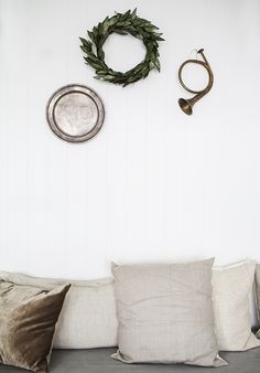 Lovely, minimalist Christmas/holiday decorations: just a little trio of natural and shiny things with simple white decor.