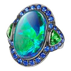 Opal Tsavorite Sapphire Gold Ring | From a unique collection of vintage cocktail rings at https://www.1stdibs.com/jewelry/rings/cocktail-rings/