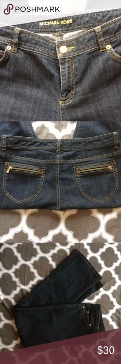 """Michael Kors Jeans Size 12 x 33 Michael Kors Boot Cut Blue Jeans with Zippers on back pockets. One zipper says MK the other is just a ring (not sure if something was attached there at one time). They are size 12 and the length is 33"""".  Medium to Dark blue wash. Michael Kors Jeans Boot Cut"""