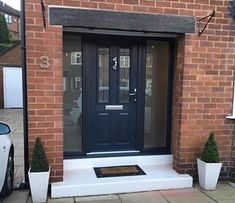 Not sure what composite door you want? Take a look at some of the beautiful composite door installations that Solidor has done and get inspired online here. Front Door Canopy, House Front Door, House With Porch, House Entrance, Entrance Hall, Porch Canopy, Entrance Ideas, Wooden Front Door Design, Front Porch Design
