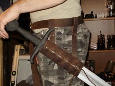 Leather scabbard to be put on a belt for latex sword, perfect for reenactment and LARP. $20.00, via Etsy. For Deb?
