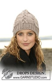 """Ravelry: 108-35 Knitted hat with cable pattern in """"Karisma"""" pattern by DROPS design"""