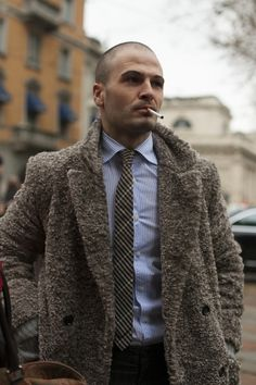 seriousness with a playfulness coat wool smoking