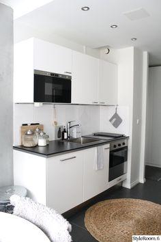 keittiö,valkoinen,keittiönkaapit,välitila,taso