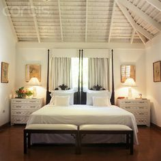wood plank ceilings | Symmetrical white bedroom with vaulted wood beam ceiling and tall twin ...