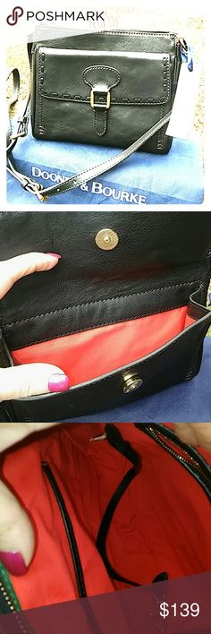 """NWT Dooney Florentine Leather flap crossbody bag NEW UNUSED Dooney & Bourke bag has the look and feel of saddlery leather. Adj shoulder strap. Front outer snap pkt, back outer zip pkt, zip top closure. Front buckle detail. Classic logo on back. Approx 8.75"""" w x 7.5""""h x 2.75""""d. 23-26"""" strap drop. Mint. No longer available!!! Dust bag inc. Next day shipping. Dooney & Bourke Bags Crossbody Bags"""
