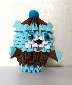 Each bear was made using modular origami techniques. Over 180 small triangles were made and assembled. The bear is approximately 3.5 inches high and has a plush pom pom on the top. Please choose your color. The price is for one bear.
