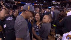 Stephen Curry celebrates the Golden State Warriors' NBA Championship win with his family, kissing his daughter, Riley.
