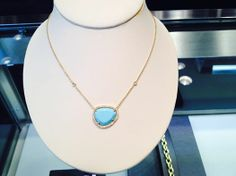 Turquoise and diamond pendant in 18kt yellow gold