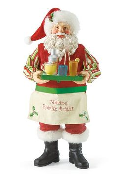 """Making Spirits Bright-Santa makes spirits and the holiday season bright in this one-of-a-kind collectible. It makes a perfect hostess gift. Santa is quite a holiday bartender as he holds his favorite Christmas spirits to share during the holiday festivities. Santa is dressed in his traditional fur-lined red hat, pants and boots and wears an apron that reads """"Making Spirits Bright"""""""