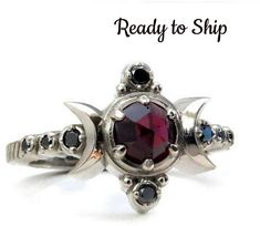 Triple moon Goddess ring - Size 4-6 - The center stone is a rose cut red garnet, and there are also 8 tiny black diamonds. Cast in solid 14k Palladium white gold, it is nickel free and we do not plate any of our metals. Recycled metals and conflict free stones.