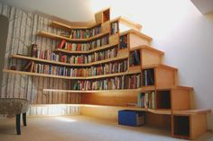 Excellent bookcases and shelves custom-made for the staircase. Mine would overflow in no time--add another story to the house!