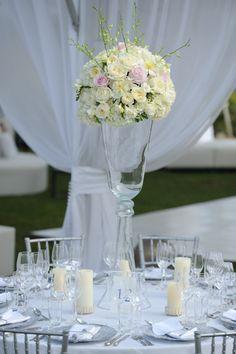 White roses, hydrangea, peonies, freesia wedding centerpiece        Photography by David Wolfe