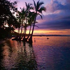 I want to watch the sunset while floating in the calm ocean.