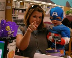 """""""Look at the camera,"""" says Mom after Connor - as Captain America - has taken his treats from our Halloween candy bucket."""