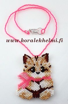 Cat pendant for a small girl. This is not my own design, I found it pattern in internet, I just changes colors.
