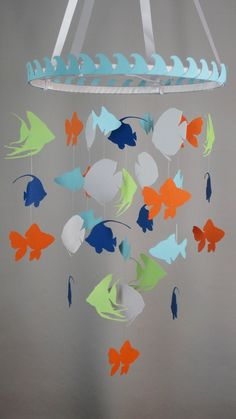 Heres a fun ceiling mobile featuring various fish silhouettes! This decorative piece is perfect above your babys crib or can be the main piece in your childs bedroom. ********************** PRODUCTION TIME ********************** This mobile is made to order and will take some time to create. MY PRODUCTION TIME IS CURRENTLY 20 DAYS. ********** DETAILS ********** This mobile hangs on a 12 inch hoop that is wrapped in white ribbon and covered in light blue waves border. This mobile is…