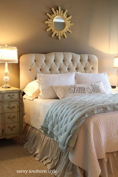 A lovely sanctuary styled bedroom, by Savvy Southern Style like the wall color and skirt color along with the blue cover. Walls frame the white bed.---I just love all these cute headboards!!!