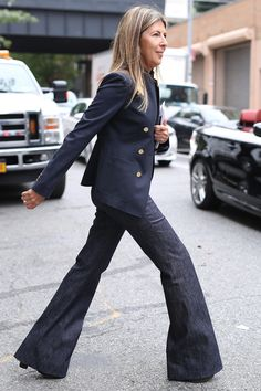 NYFW Street Style Day 6: Nina Garcia kept it classic in her staples — a blazer and wide-leg denim.
