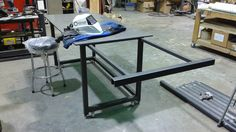 Welding table features a side extension for doing longer work.