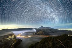 Hundreds of stars appear to spin in the sky above Mount Bromo - an active volcano in East Java, Indonesia. This time-lapse composite photo was taken by Malaysian photographer Grey Chow - who has captured stunning night-time images across South East Asia.