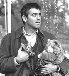 "George Clooney in the movie, ""One Fine Day"", holding the Bengal kitten (there were actually 4 different Bengal kittens used during the filming portraying only 1 kitten)."