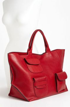 MARNI Leather Tote, red, is a sizable bag with several exterior pockets, crafted from lush pebbled leather with inverted, black-edged seaming. Magnetic-snap closure. Interior zip, wall and cell-phone pockets. Made in Italy.