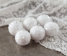 Mini Spun Cotton Snowballs - Miniature Christmas Ornaments, Set of 6 Six shimmering white miniature snowball ornaments. These are made out of German spun cotton balls, decorated with a blend of snow c