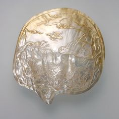 carved mother of pearl seaside scene