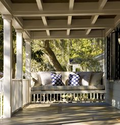 Porch swing. Coffered ceiling. The perfect place to sit and watch the world go by...