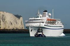 MS Athena Cruise Ship before the White Cliffs of Dover, Kent, England, UK. As MS Stockholm involved in SS Andrea Doria maritime disaster in 1956. Operator CIC Classic International Cruises. En route from Calais (France) to Newhaven. IMO 5383304, MMSI 255801380, Call Sign CQRV. Eastern Arm behind ship. On way to CT1, Admiralty Pier. Dover Harbour Board DHB Dauntless tug. View: Prince of Wales Pier. 2010 Port of Dover travel, tourism, and holiday photo. See…