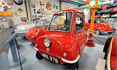 1964 Peel P50 at the Bruce Weiner Microcar Museum. The car, which has no reverse gear, has a handle in the rear so the car can be lifted and turned around.
