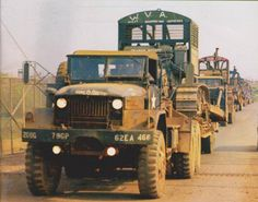 M123A1C Truck, Tractor, 10-Ton, 6x6 vehicles in convoy, each with a trailer carrying a Rome Plow bulldozer, Long Binh, Vietnam, 21 April 1970. 984th Land Clearing Company, 62nd Engineer Battalion.