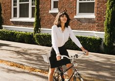 """The Reveal Skirt provides women with a tailored, straight skirt that unzips in the back to expose 12"""" of additional fabric at the bottom hem for easy pedaling while biking."""