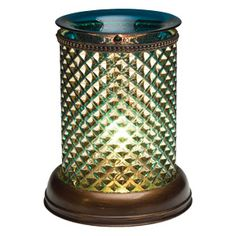 Brilliant diamond shapes adorn this stunning glass cylinder, casting spellbinding patterns in sky blue.