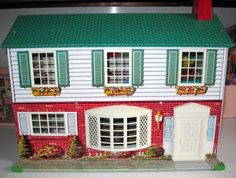 Great 50's tin doll house! I had this same doll house when I was little in the 1960's. I loved it.
