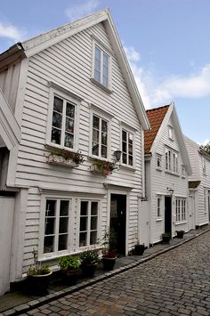 Stavanger, Norway...love these row houses with the cobble street.